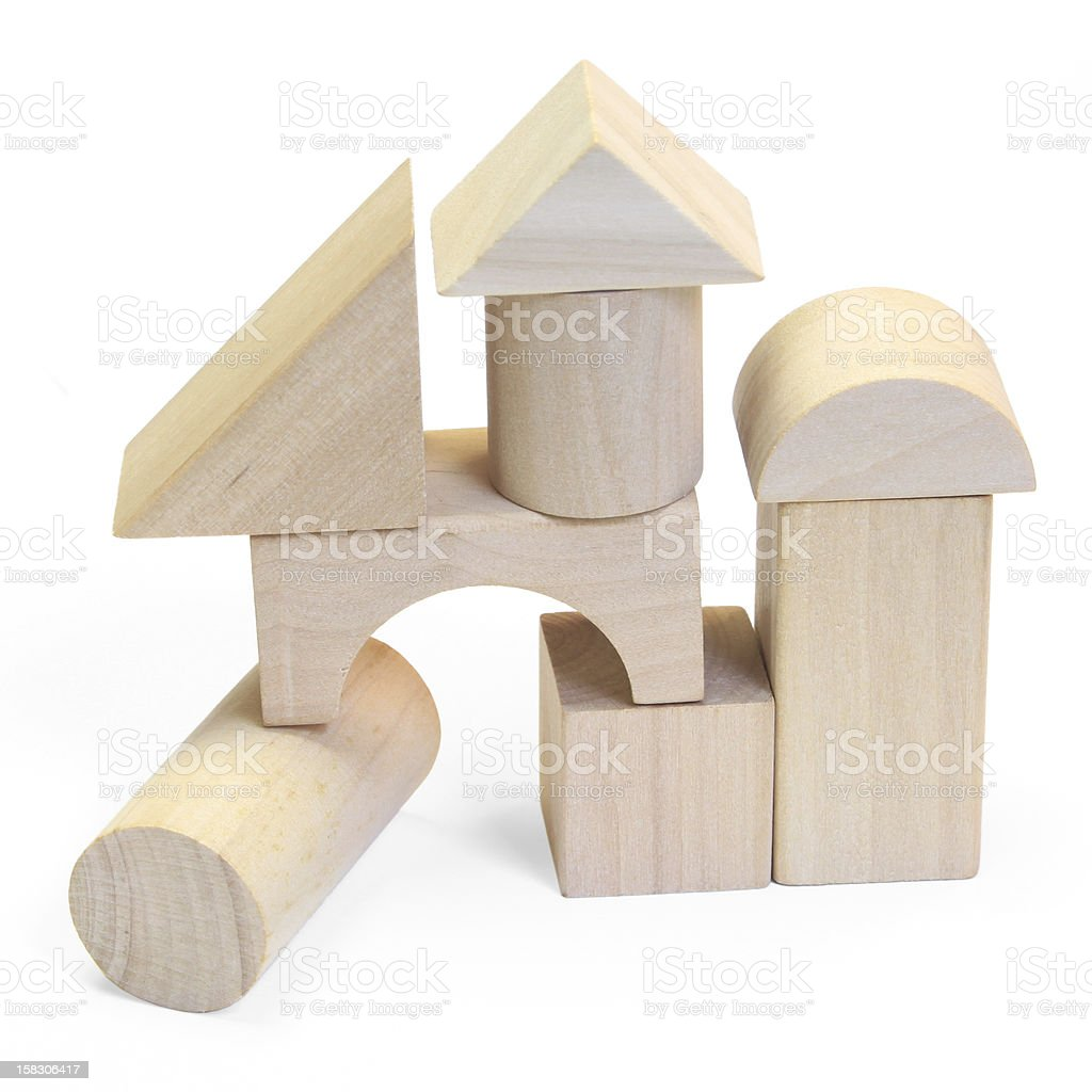 wooden building blocks on a white background stock photo