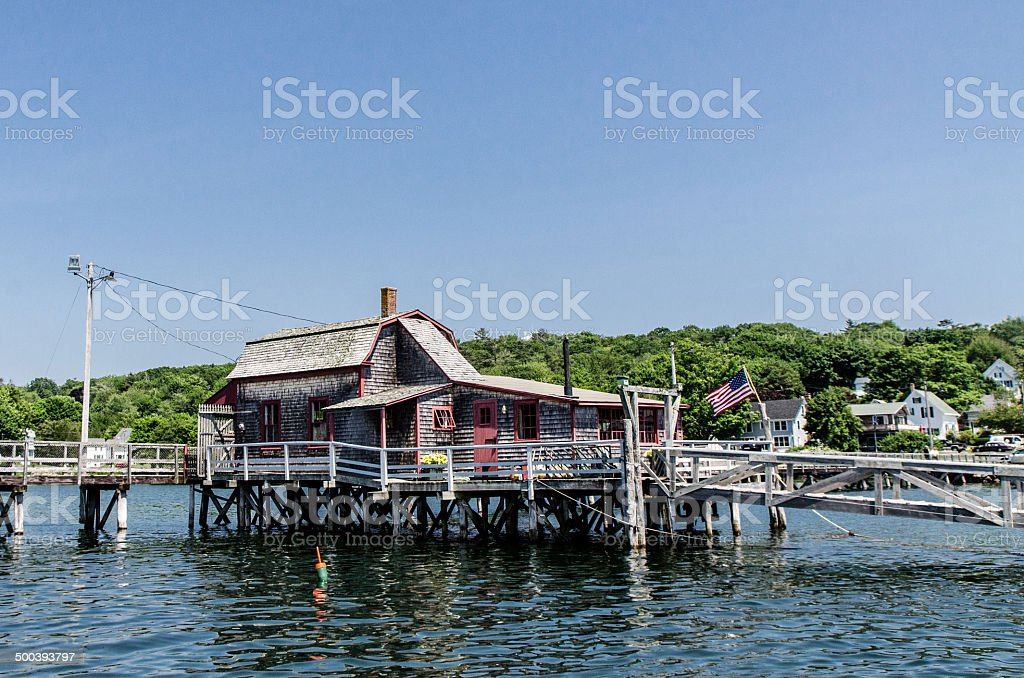 Wooden building over water stock photo