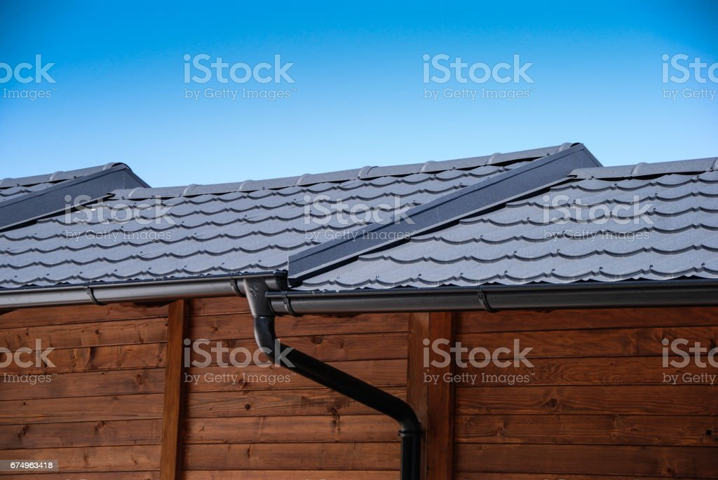 Wooden buildings with black metal roof tile stock photo
