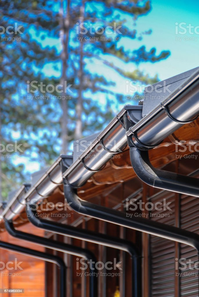 Wooden buildings with black steel rain gutters stock photo