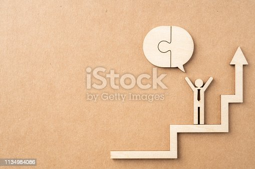 istock wooden businessman with conversation concept 1134984086