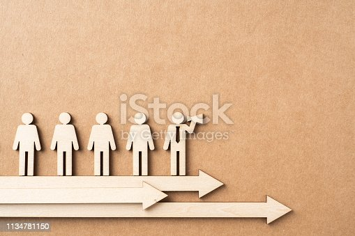 istock wooden businessman with leadership concept 1134781150