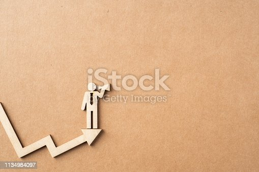 istock wooden businessman with leadership concept 1134984097
