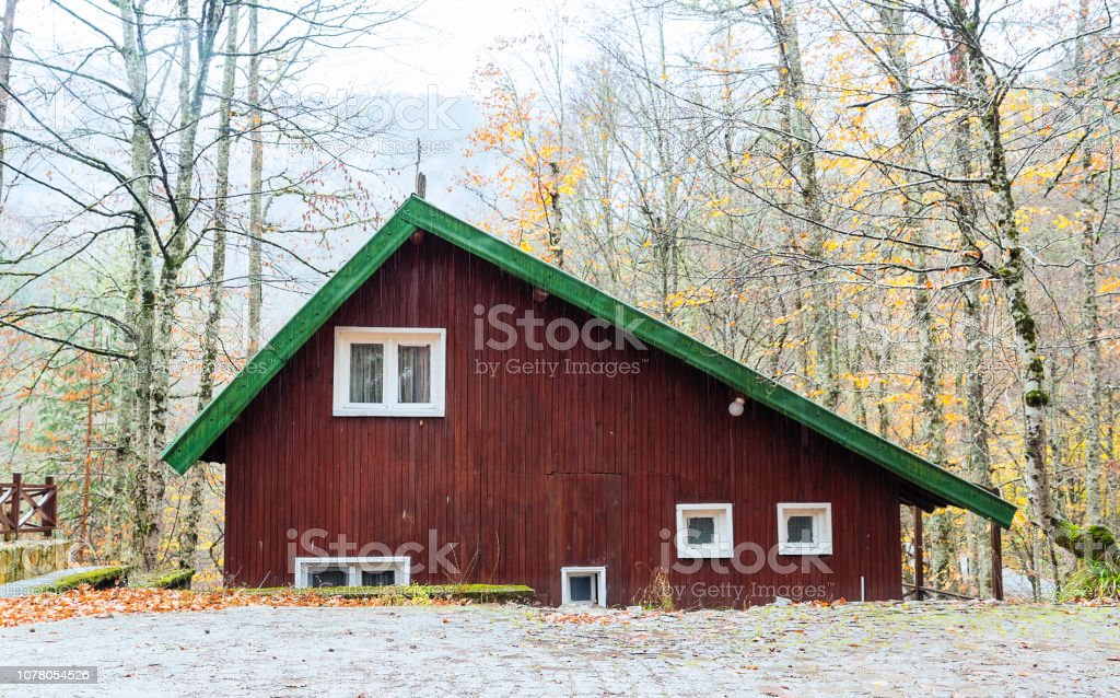 Wooden cabin house in nature