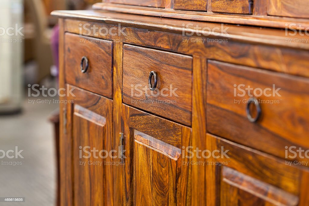 Wooden cabinet with drawers and handles stock photo