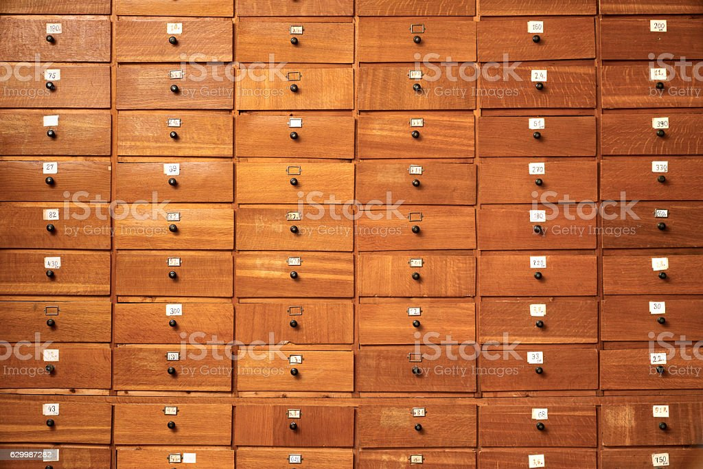 Wooden cabinet with drawers stock photo