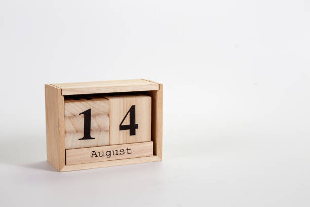 Wooden calendar August 14 on a white background stock photo