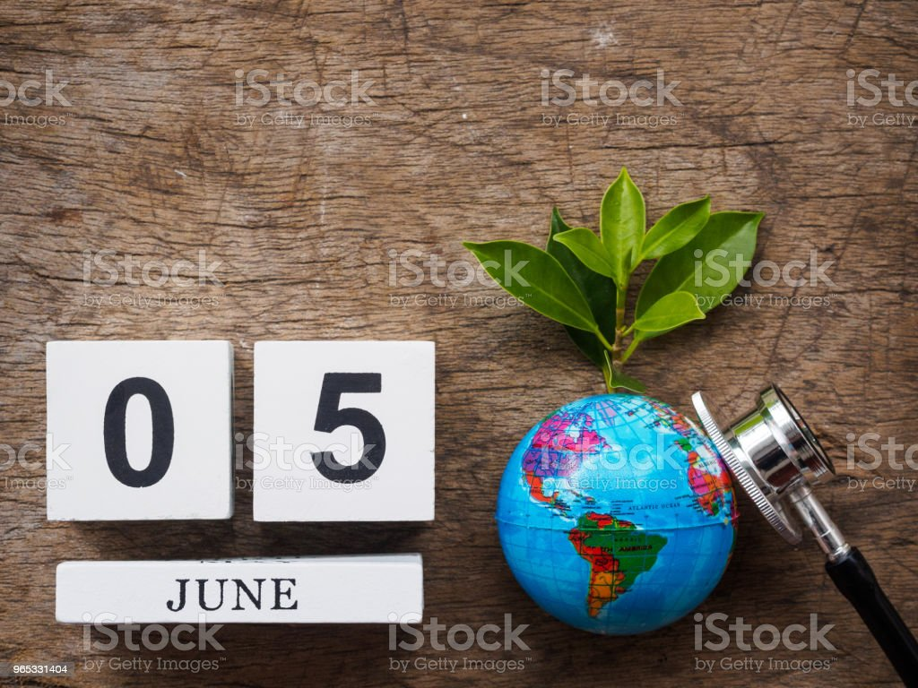 05 JUNE wooden calendar block, globe and stethoscope on wooden texture background top view. World Environment day concept. zbiór zdjęć royalty-free