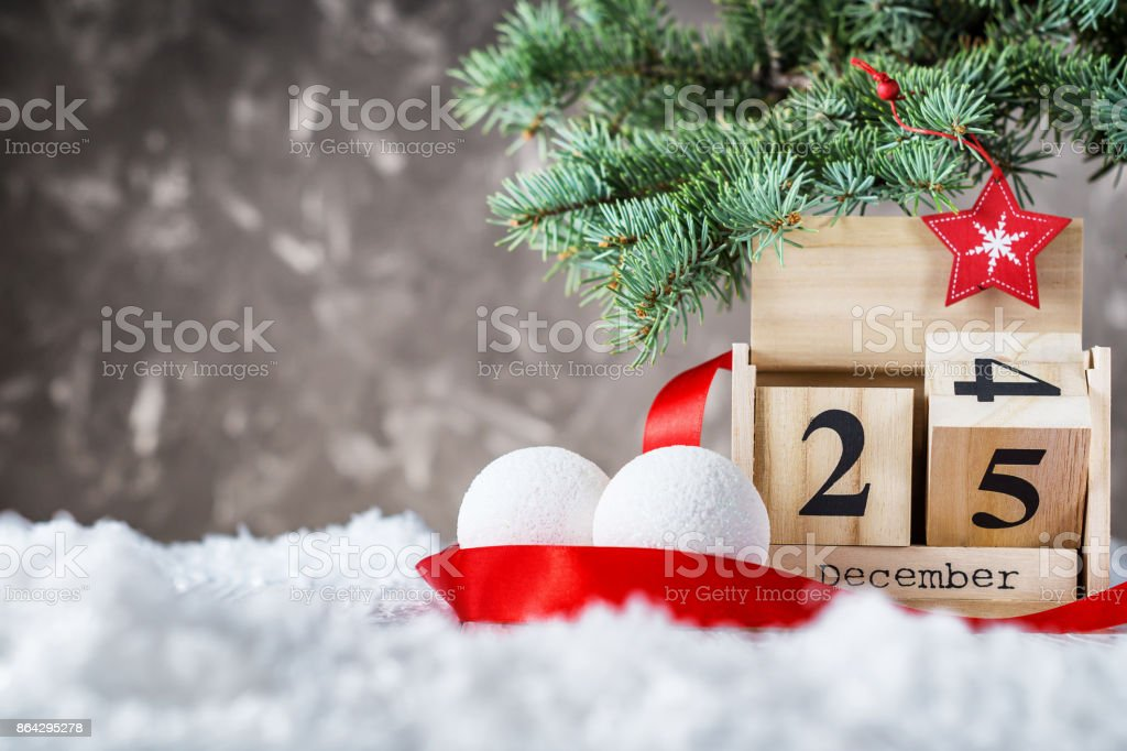 Wooden calendar set on the 25 of december stock photo