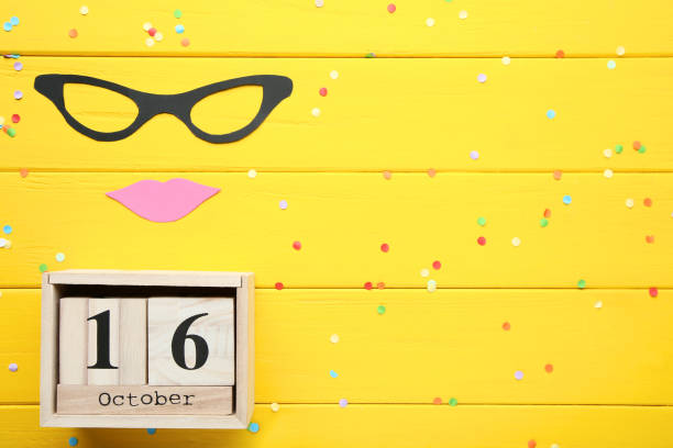 Wooden calendar with paper glasses and lips. Boss day concept Wooden calendar with paper glasses and lips. Boss day concept boss's day stock pictures, royalty-free photos & images