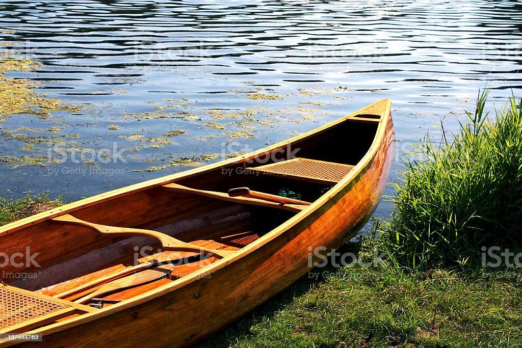 Wooden Canoe on Beach royalty-free stock photo