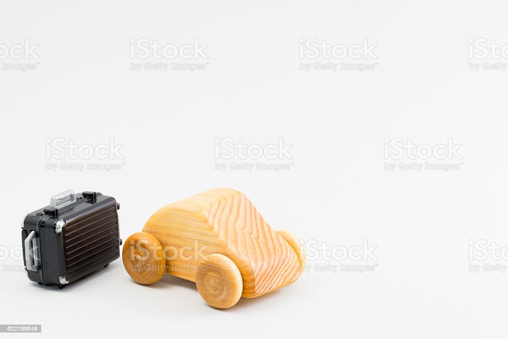Wooden car and miniature of the suitcase stock photo