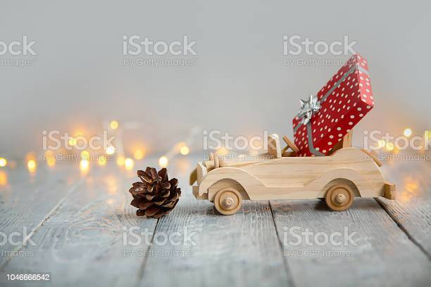 Wooden car with gift on a wooden gray background and lights from the picture id1046666542?b=1&k=6&m=1046666542&s=612x612&h=5yd6wjs4kledzw g4q5iecdb5xymngoegn1aczzcoau=