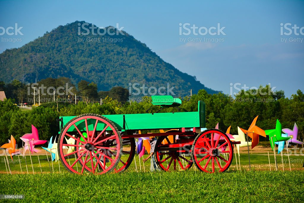 Wooden cart in the garden stock photo