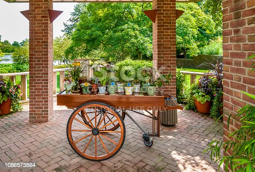 Glencoe, Illinois, United States - August 20, 2014: Wooden cart with flowers and plants in the Chicago Botanic Garden.