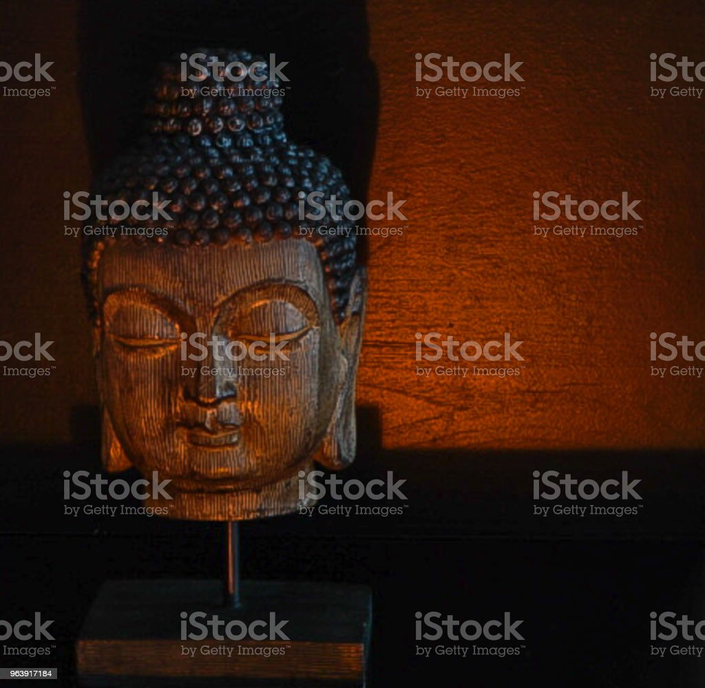 Wooden Carved Buddhist Head with Black Background in candlelight - Royalty-free Ancient Stock Photo