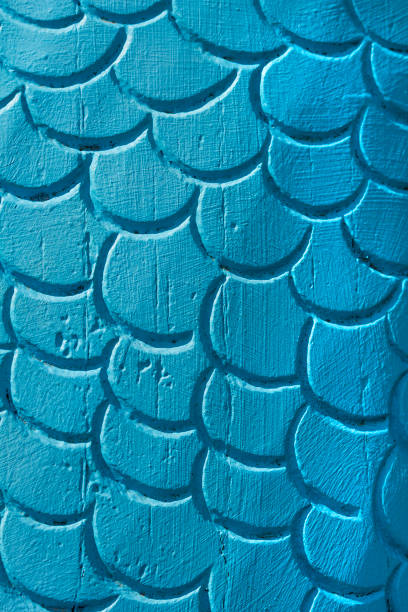 Wooden carved fish scales stock photo