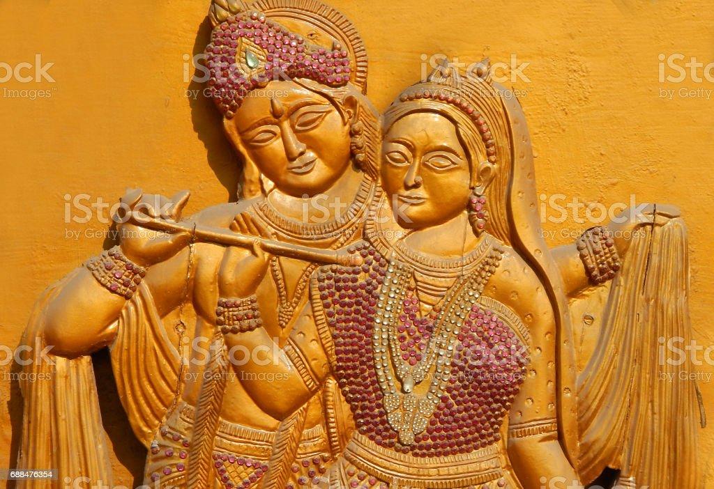 Wooden carving of Hindu god Sri Krishna and Goddess Radha as is in mahabharata epic , Hyderabad,India stock photo