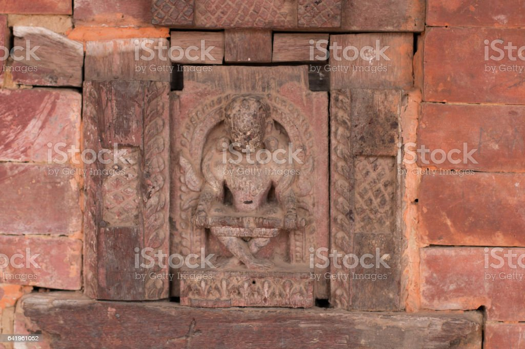 Wooden carving of mythological creature, Bhaktapur, Kathmandu stock photo