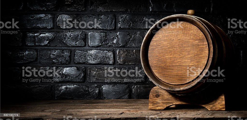 Wooden cask and bricks stock photo