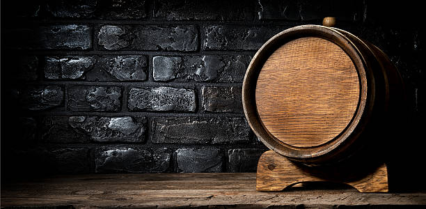 Wooden cask and bricks Wooden cask and wall made of bricks cellar stock pictures, royalty-free photos & images