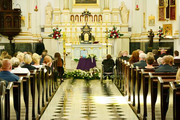 Wooden casket at a funeral - funeral ceremony in church stock photo