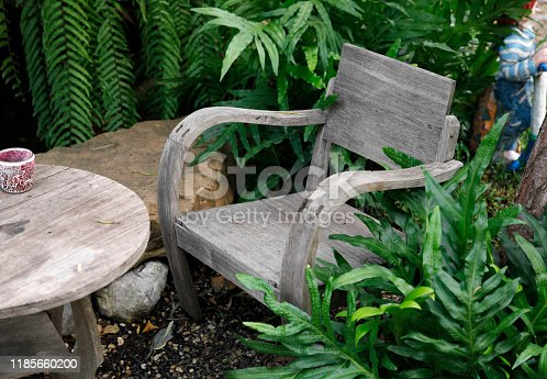 647209792 istock photo wooden chair and table in the cafe garden 1185660200