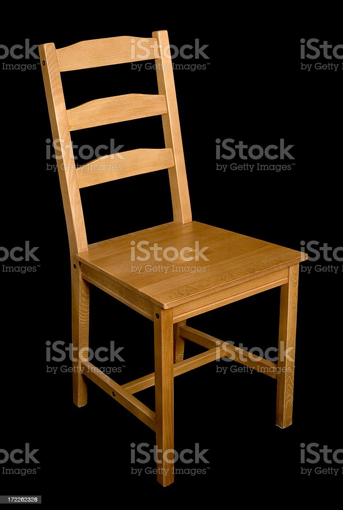 Wooden chair on black royalty-free stock photo