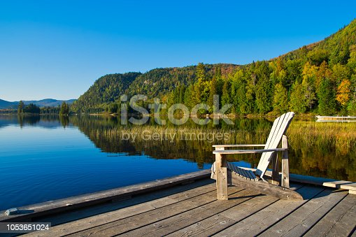 Wooden chair on lakeside pier