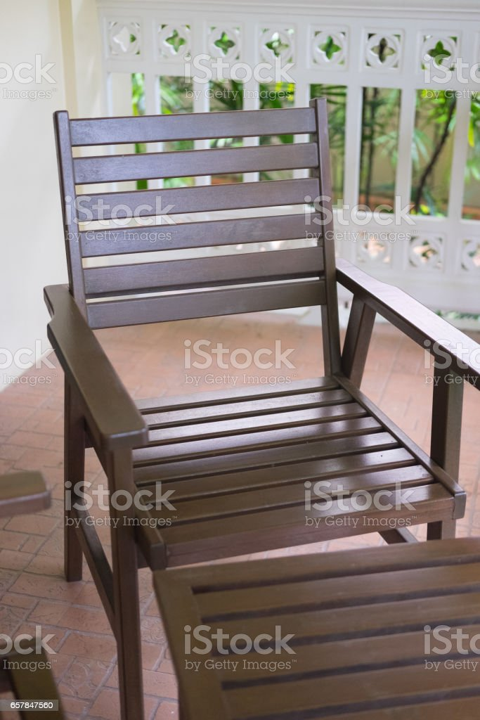wooden chair on the balcony at home stock photo