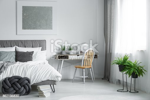 istock Wooden chair standing by desk 862196830