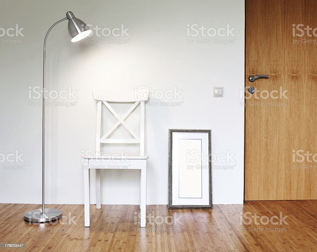 Wooden Chair with floor lamp stock photo