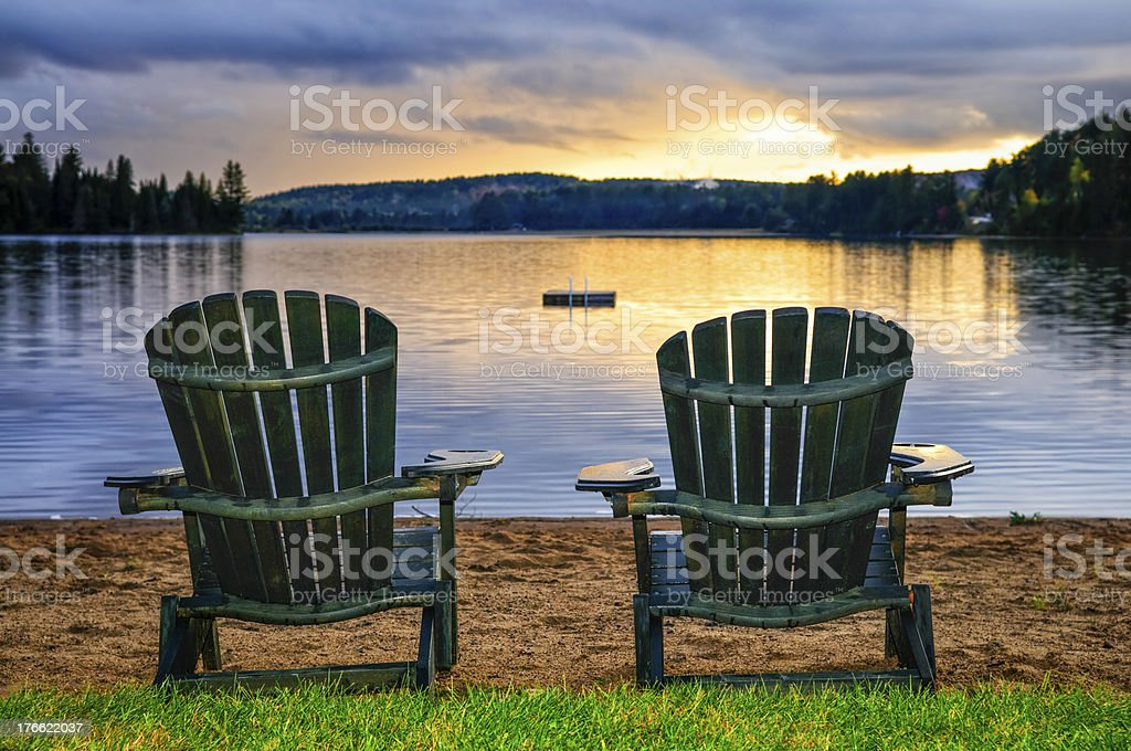 Wooden chairs at a sunset on the beach stock photo