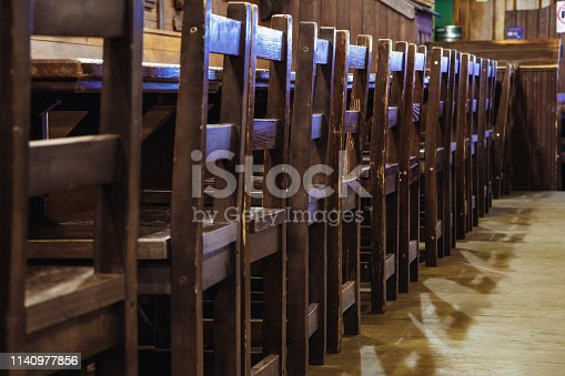 647209792 istock photo wooden chairs in vintage style in a beer pub or in a restaurant. 1140977856