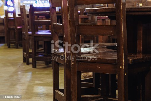647209792 istock photo wooden chairs in vintage style in a beer pub or in a restaurant. 1140977907