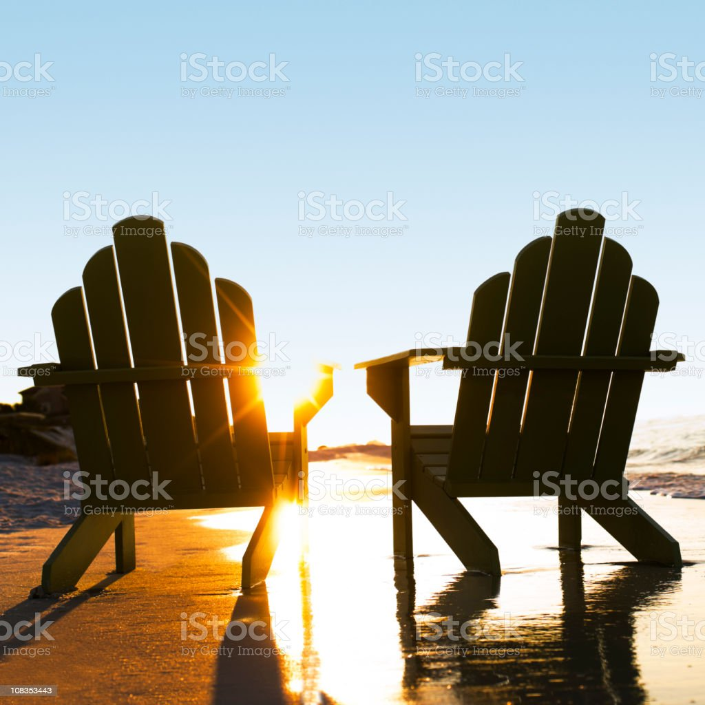 Wooden Chairs on Beach royalty-free stock photo