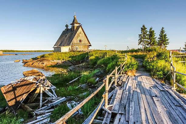 Wooden chapel on sea shore Old church stands alone on the  on coast. Rabocheostrovsk. Karelia.Russia republic of karelia russia stock pictures, royalty-free photos & images