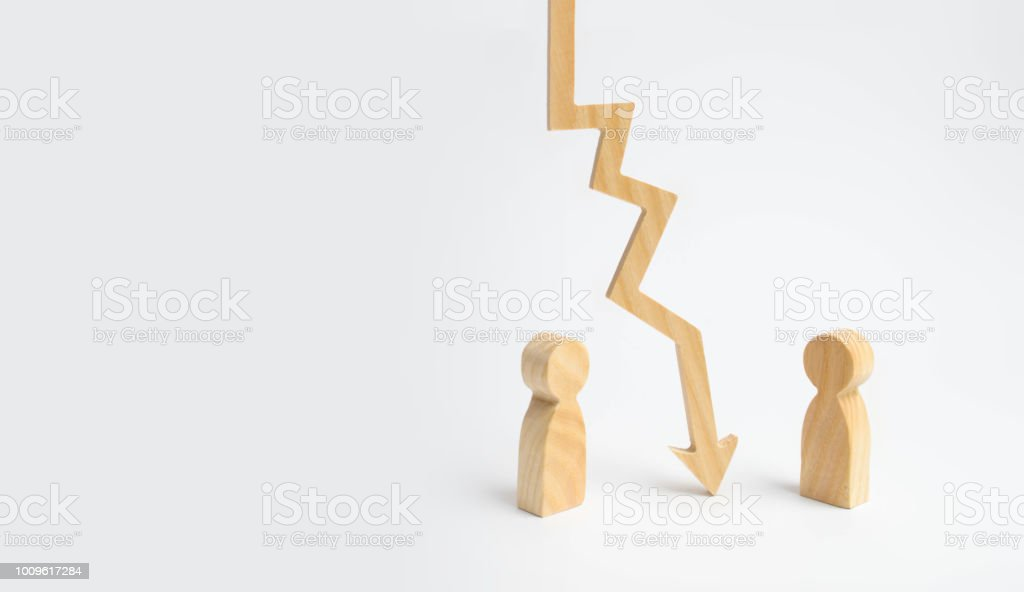 A wooden chart arrow down divides the two people discussing the case. Termination and breakdown of relations, breaking ties. Contract break, conflict of interests. Negotiations of businessmen. stock photo