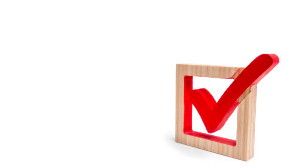 A wooden checkmark in the box on a white isolated background. The concept of suffrage, voting in elections. Election of the President or Government. Democracy, development, civil initiative. stock photo