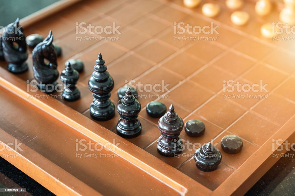 Wooden chess board game with chess pieces set of ready to play