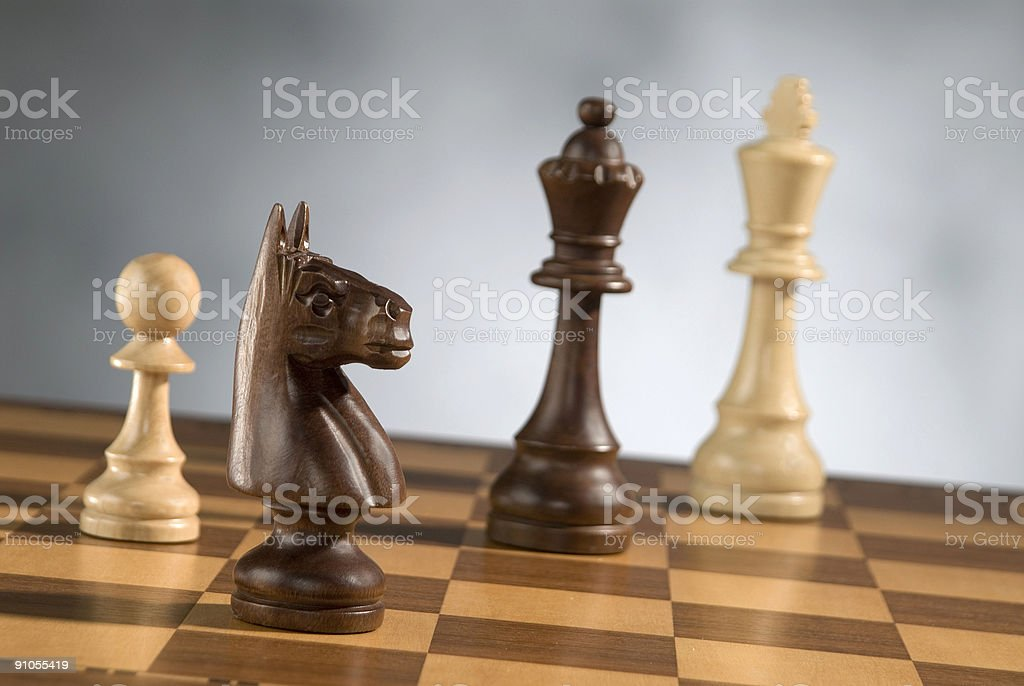 wooden chess game pieces royalty-free stock photo
