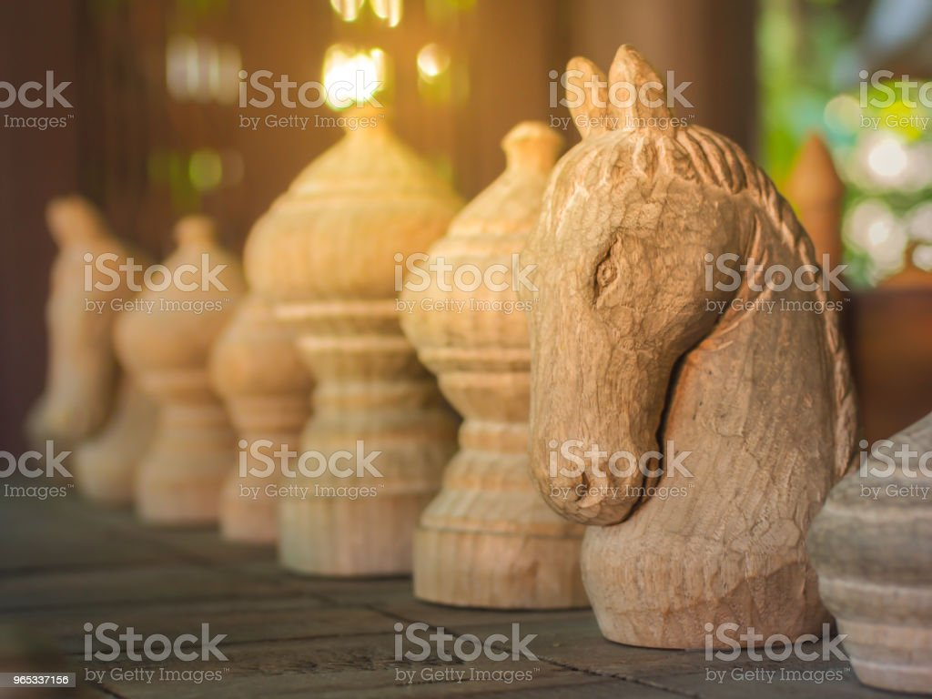 Wooden chess horse pieces. royalty-free stock photo