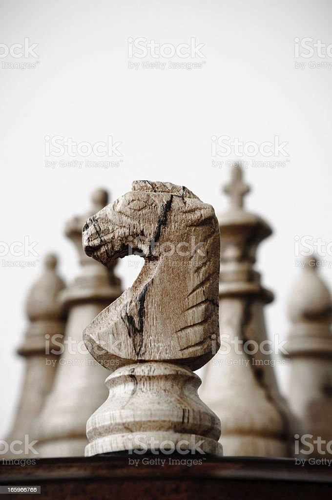 Wooden chess knight and pieces stock photo