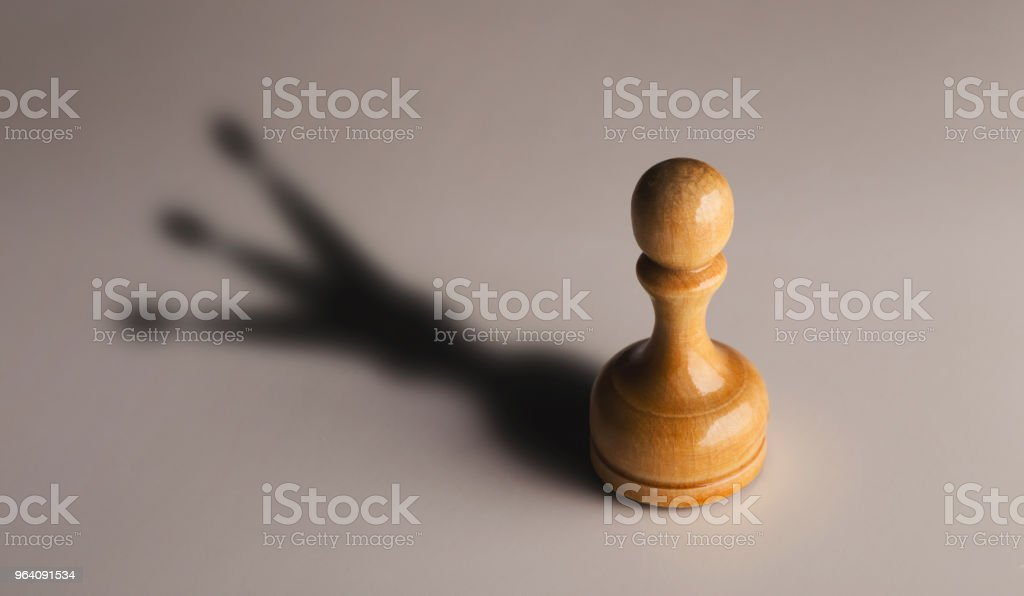 Wooden chess pawn with king shadow - Royalty-free Achievement Stock Photo