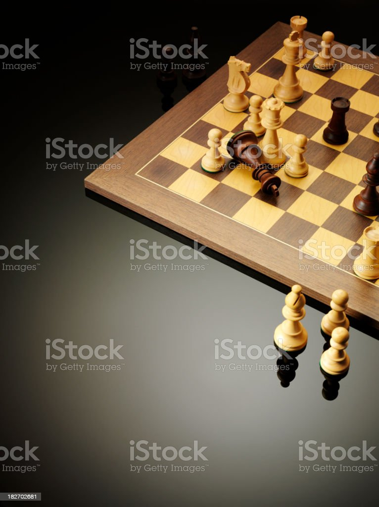 Wooden Chess Pieces on a Board royalty-free stock photo