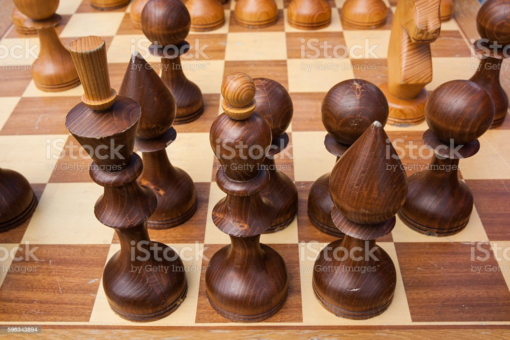 Wooden chess pieces on a chess board royalty-free stock photo