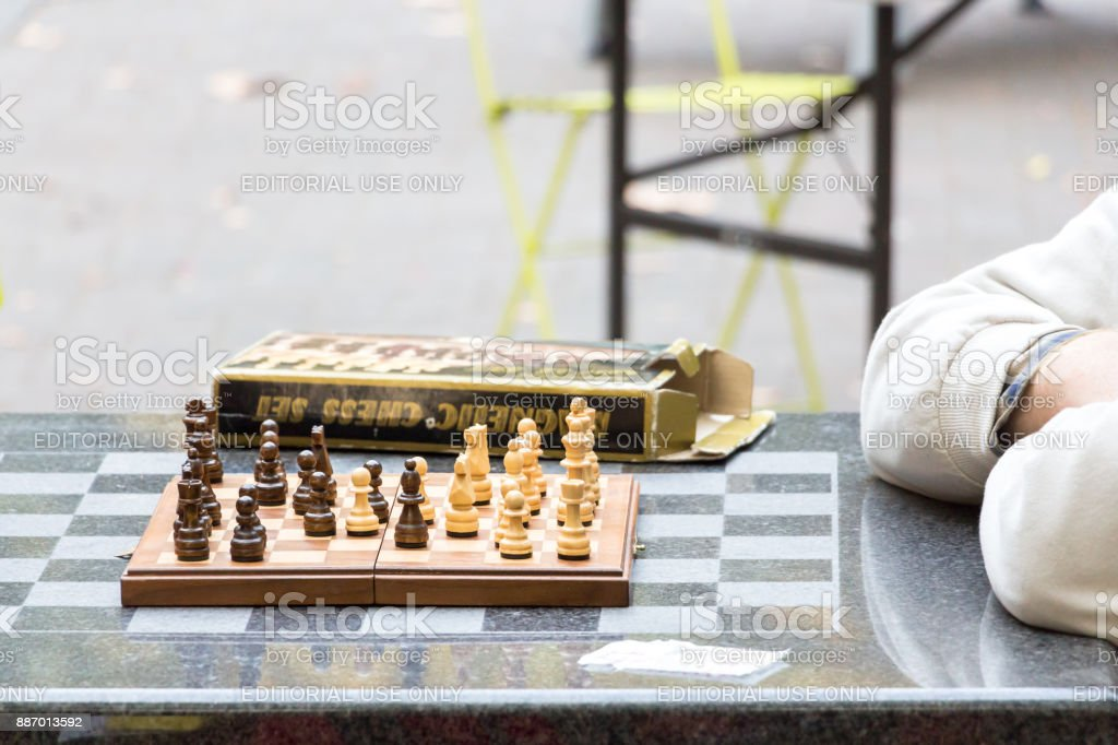 Wooden chessboard on a granite table  at Pioneer Square. stock photo