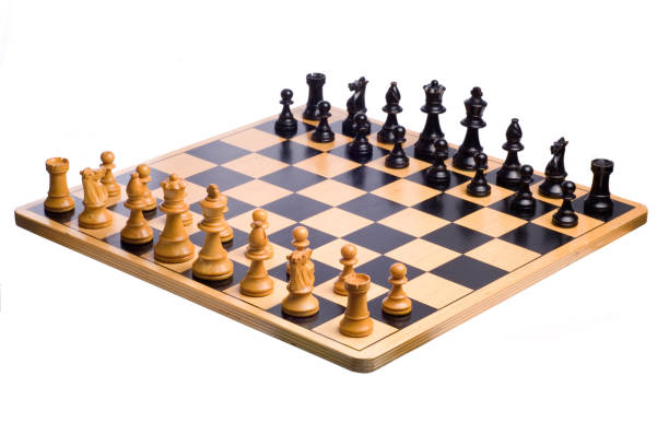 A wooden chessboard set up prior to play stock photo
