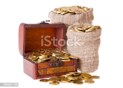 istock Wooden chest and two bags filled with coins. 1065861766