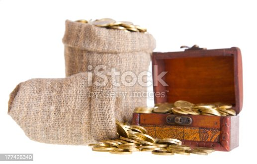 istock Wooden chest and two bags filled with coins 177426340